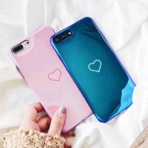 2 telephones portables bleus et roses